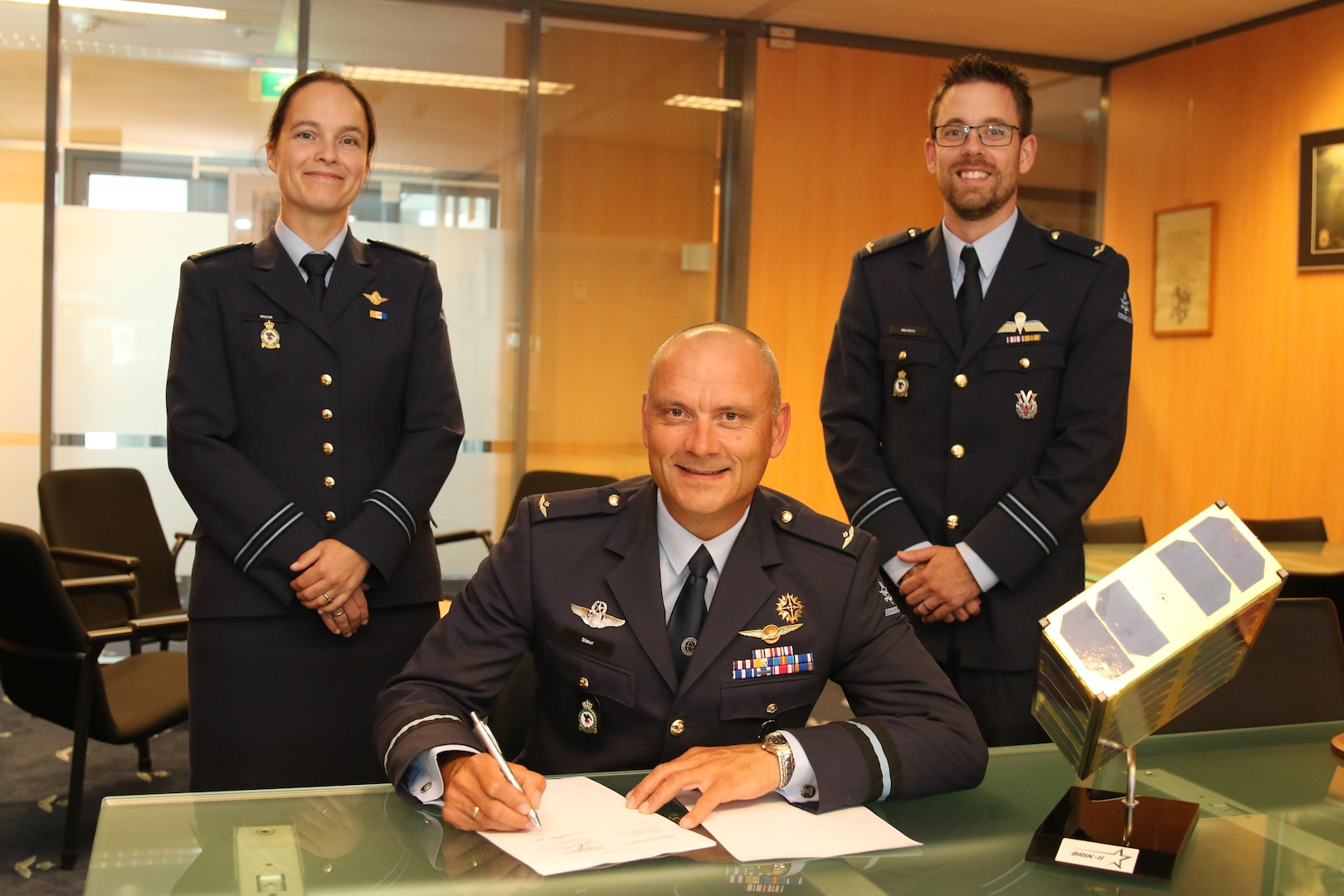 Royal Netherlands Air Force Air Commodore Andre Steur, Director of operations signs the MOU at Royal Netherlands Air Force Headquarters.