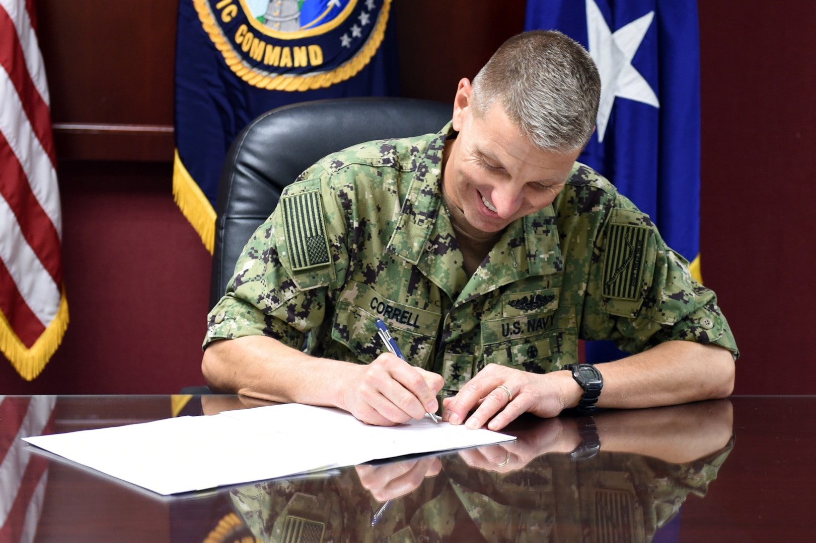 U.S. Navy Rear Adm. Richard Correll, U.S. Strategic Command (USSTRATCOM) director of plans and policy, signs an agreement to share Space Situational Awareness services and information with Netherlands at USSTRATCOM headquarters on Offutt Air Force Base, Neb., Sept. 21, 2018.
