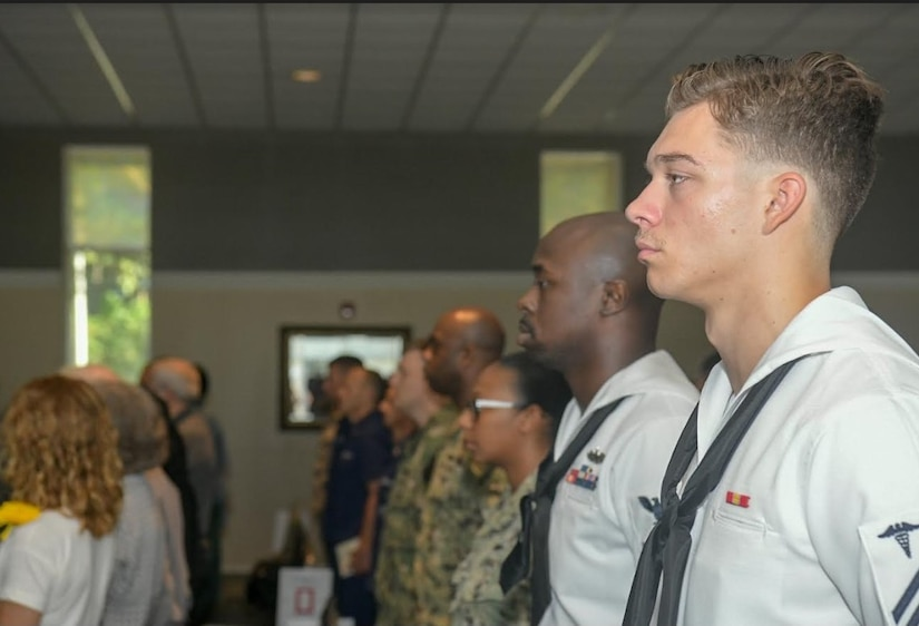 Sailors, Airmen and family members of fallen service members, gather during the Bells Across America memorial ceremony Sept. 27, 2018, at Joint Base Charleston, S.C. The ceremony is an annual U.S. military tradition held across the country to honor and commemorate fallen service members. During the ceremony, a bell is rung after each service member's name is read.