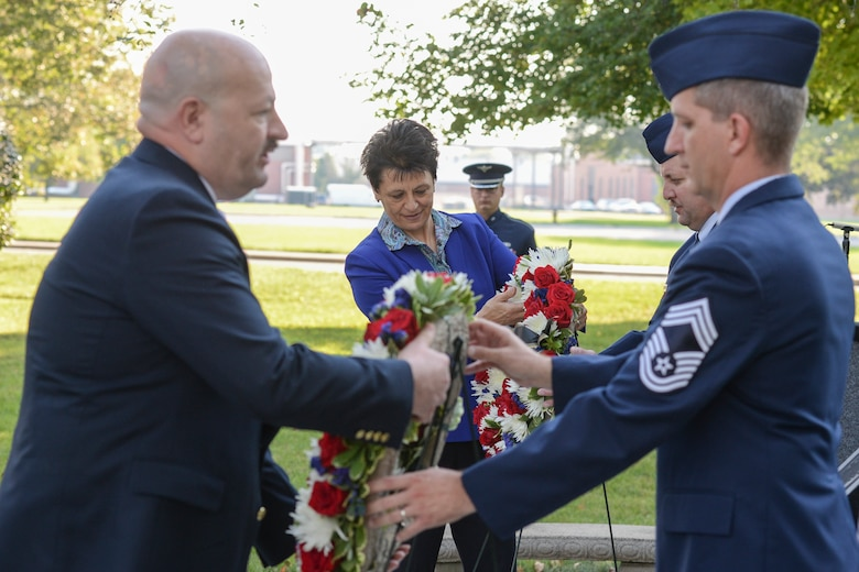 Retired Air Force Col. Cassie Barlow, president of the Miami Valley Military Affairs Association, and Retired Senior Master Sgt. David McCoy, president of Chapter 751 of the Air Force Sergeants Association, lay wreaths at the POW/MIA Recognition Day Memorial at the Arnold House during a ceremony at Wright-Patterson Air Force Base Sept. 21. (U.S. Air Force photo/Wesley Farnsworth)