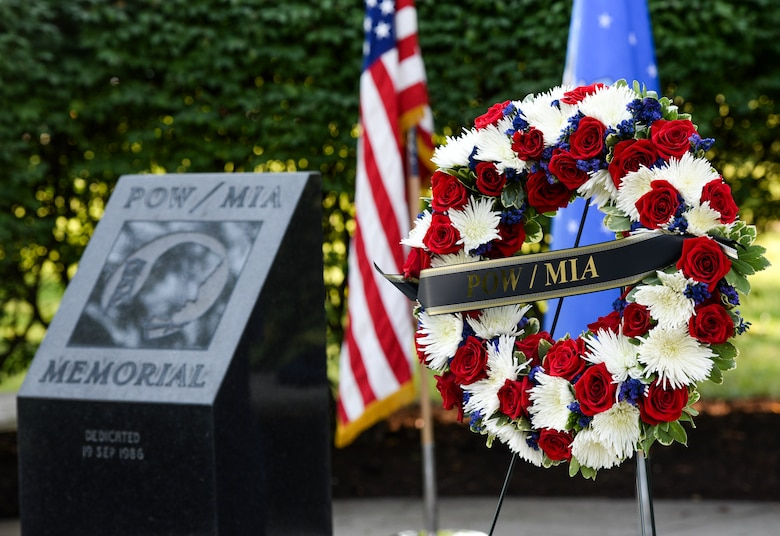A wreath sits on a stand at the POW/MIA memorial at the Arnold House in Area A, Wright-Patterson Air Force Base Sept. 21. The wreath was placed during a POW/MIA ceremony which was held for base personnel as part of National POW/MIA Recognition Day. (U.S. Air Force photo/Wesley Farnsworth)