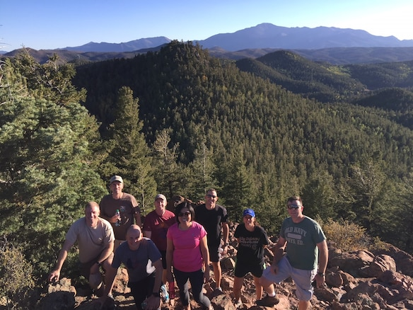 A small group of 340th Flying Training Group Commanders Summit attendees pause for a photo opportunity during a hike to Eagles Peak outside of Colorado springs, Colorado. Incorporating such teambuilding activities in leadership summits helps strengthen team relationships. Front row, left to right, are 340th FTG Commander Col. Allen Duckworth, 5th Flying Training Squadron Commander Lt. Col. Matthew Johnson, and 340th FTG Deputy Commander Col. Janette Thode. Back row, left to right, are Lt. Col. Daniel Scheuermann, 97th FTS; Lt. Col. James Halstead, 340th FTG; Lt. Col. William Pope, 96th FTS; Lt. Col. Kristen Kent, 39th FTS; and Lt. Col. Travis Higbee, 5th FTS. (U.S. Air Force photo by Lt. Col. Brian Frisbey)