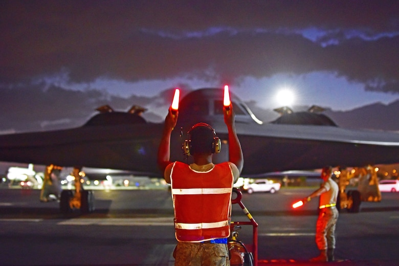 Airman 1st Class Christopher Rucker, a crew chief assigned to the 509th Aircraft Maintenance Squadron, marshals a B-2 Spirit returning from a routine training mission at Joint Base Pearl Harbor-Hickam, Hawaii, Sept. 6, 2018. The B-2s deployed to JBPH-H from Whiteman Air Force Base, Mo., in support of the U.S. Strategic Command's Bomber Task Force deployment. USSTRATCOM regularly tests and evaluates the readiness of strategic assets to ensure they can honor U.S. security commitments. (U.S. Air Force photo by Staff Sgt. Danielle Quilla)