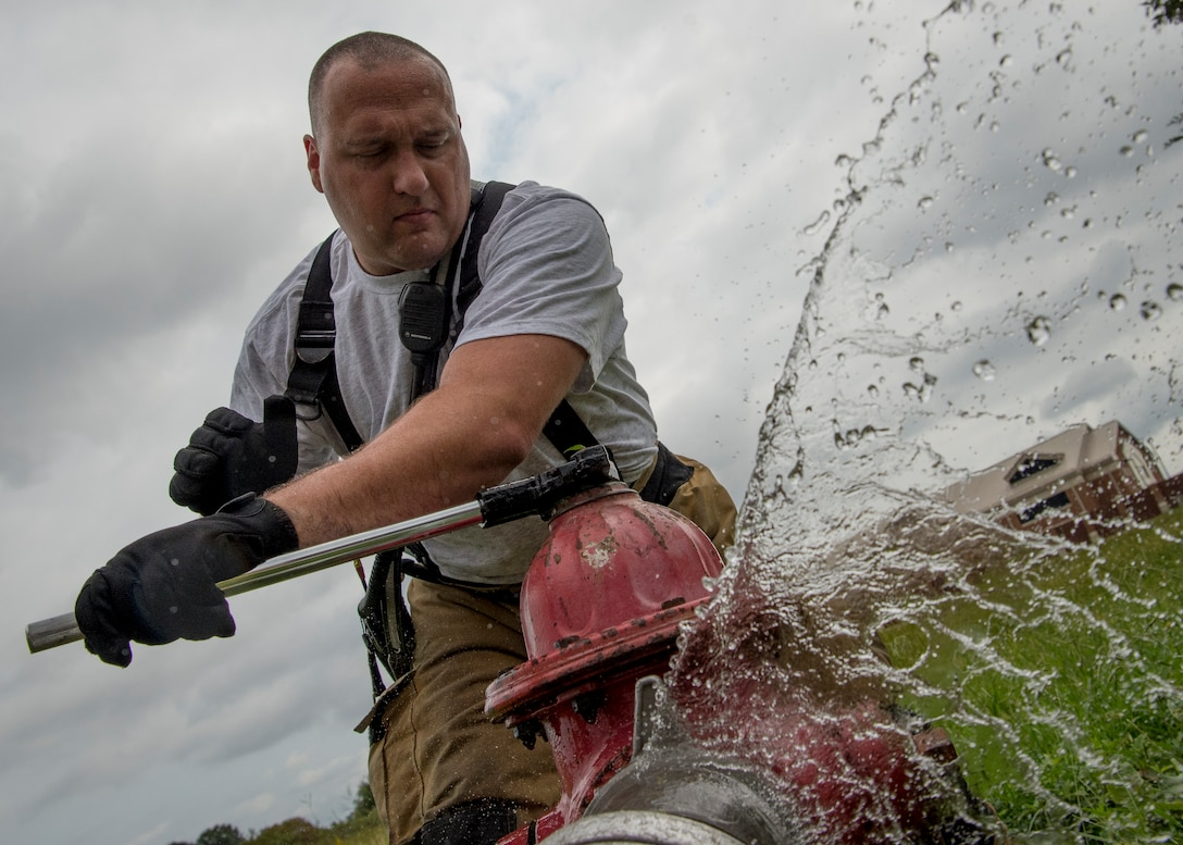 James Sneddon, 633rd Civil Engineer Squadron lead firefighter, participates in a fire training exercise at Joint Base Langley-Eustis, Va., Sept. 20, 2018. During the exercise, firefighters participated in real-world scenarios, including fixing broken fire hydrants as well as finding alternate locations to supplement their water needs at response sites. (U.S. Air Force photo by Staff Sgt. Areca T. Bell)