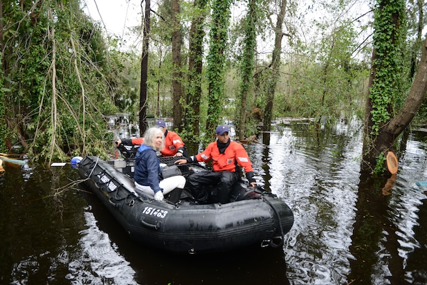 Coast Guard personnel rescue an elderly woman and her husband along with their pets after their home was flooded by Hurricane Florence, in Brunswick County, North Carolina, Sept. 16, 2018.