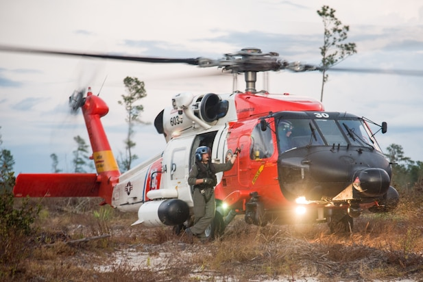 A Coast Guard Air Station Clearwater MH-60 Jayhawk aircrew search for survivors of Hurricane Florence in North Carolina, Sept. 18, 2018.  Coast Guard air stations from around the country have sent aircraft and personnel to Air Station Elizabeth City, where response efforts are being coordinated.