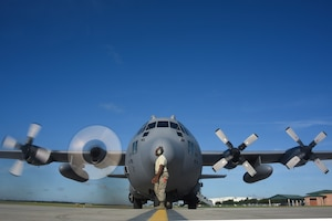 Crew chief prepares C-130 for takeoff.