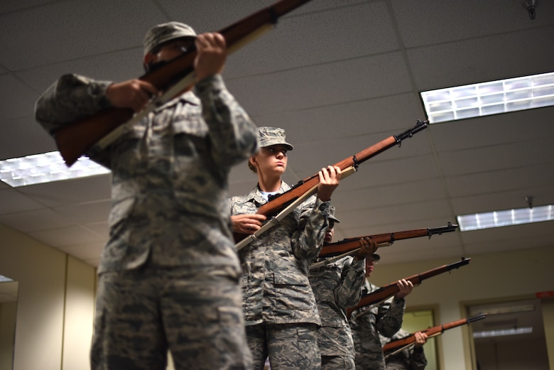 Members of the Goodfellow Honor Guard train by participating in a game of elimination in the honor guard practice room on Goodfellow Air Force Base, Texas, Sept. 21, 2018. Maneuvers are called and if incorrectly executed that member is eliminated, the last person to correctly execute all the movements wins. (U.S. Air Force photo by Airman 1st Class Seraiah Hines/Released)