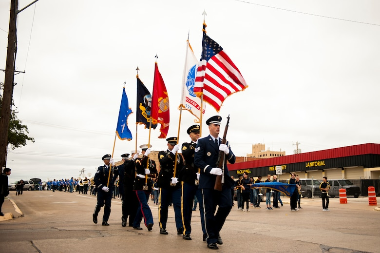 Members of the Goodfellow Joint Service Color Guard participate in the Veteran's Day Parade through downtown San Angleo, Texas, Nov. 11, 2017. In addition to providing Military Honors at funerals, Goodfellow Honor Guard members will participate in various events with the Joint Service Color Guard. (U.S. Air Force photo by Senior Airman Scott Jackson/Released)