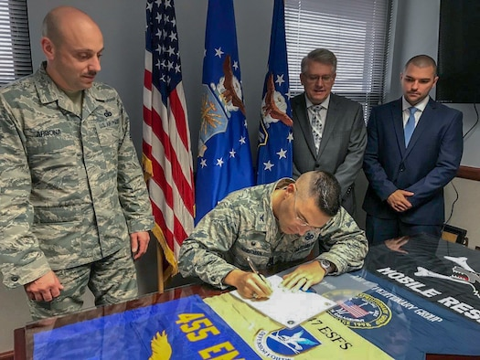 Col. Thomas Sherman, 88th Air Base Wing and Installation commander, signs a proclaimation to declare October 2018 as Wright-Patterson Air Force Base Energy Action Month