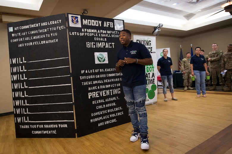 Staff Sgt. Darrius Williams, 23d Medical Group Green Dot instructor, addresses the crowd during the unveiling of the Green Dot Commitment Board, Sept. 28, 2018, at Moody Air Force Base, Ga. The board was crafted for Airmen and by Airmen and will travel across the base allowing Airmen to write down their individual commitments. Green Dot is an Air Force program designed to reinforce the key principles of prevention that can be applied to many issues such as sexual assault, suicide prevention, domestic violence, stalking and child abuse prevention.