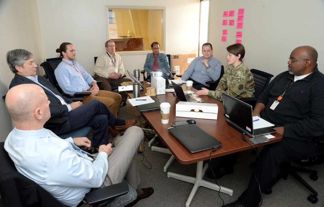 Maj. Kayla Ramotar, second from right, Holistic Health and Fitness action officer and command dietitian from the Army Center for Initial Military Training, leads a group discussion during a Value Engineering workshop at Huntsville Center in March to examine the Army's proposed Soldier Physical Readiness Centers.