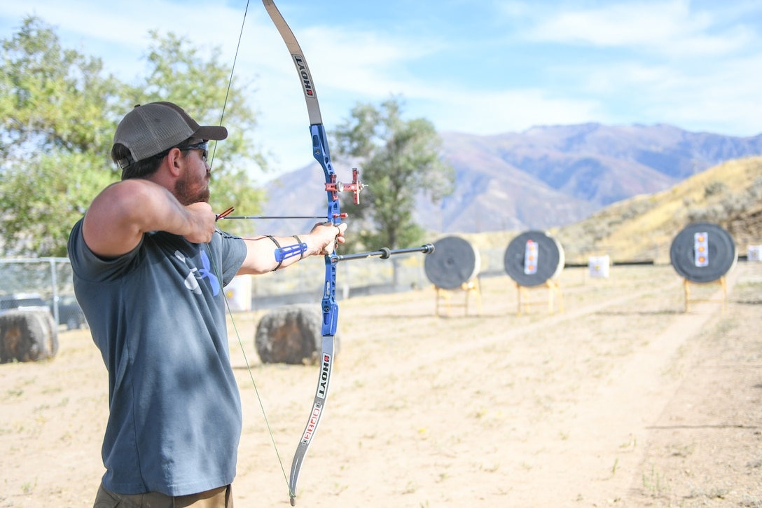 Marine Staff Sgt. James Dunaway from Mission Valley, Calif., aims his recurve bow during a Paralympic Archery Training Camp Sept. 25, 2018, at Hill Air Force Base, Utah. Hill hosted the camp Sept. 24-28 through the Paralympic Military Program, which is run by the United States Olympic Committee in partnership with the U.S. Department of Defense and U.S. Department of Veterans Affairs. (U.S. Air Force photo by Cynthia Griggs)