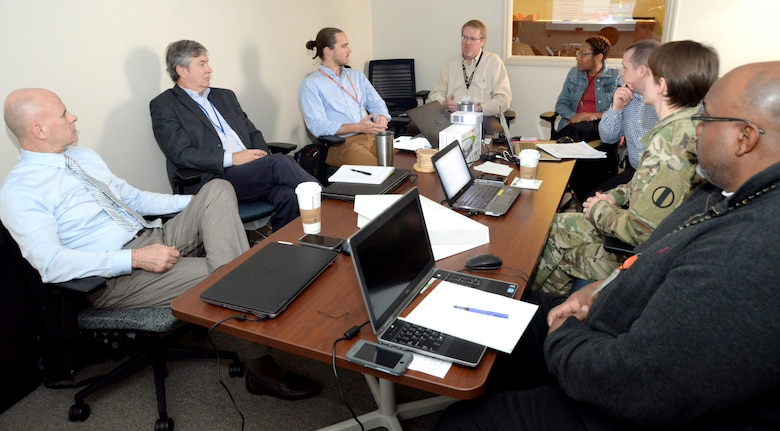 Vernon Petty, fourth from left, project manager for costs with the Center of Standardization at Huntsville Center, and Tiffany Torres, fifth from left, Value Engineering officer and value program manager, help facilitate a Value Engineering workshop in March with members of the Army Center for Initial Military Training in March at Huntsville Center to examine the Army's proposed Soldier Physical Readiness Centers.