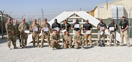 Contractors, Soldiers and Department of the Army Civilians congratulate contestants of the K9 Competition that occurred here on Bagram Airfield, Afghanistan. The K9 competition, held September 16, 2018, consisted of four events: detection, obedience, agility and controlled aggression. In each event, the working dog teams were evaluated on their expedience to complete the task, their accuracy, their focus and their obedience to their handler's commands. Based on these evaluations, the nine working dog teams (three U.S. Army teams and six AMK9 contractor teams) were awarded corresponding points and the team that ended up with the most points won. (U.S. Army photo by: Staff Sgt. Caitlyn Byrne, 101st Sustainment Brigade Public Affairs)