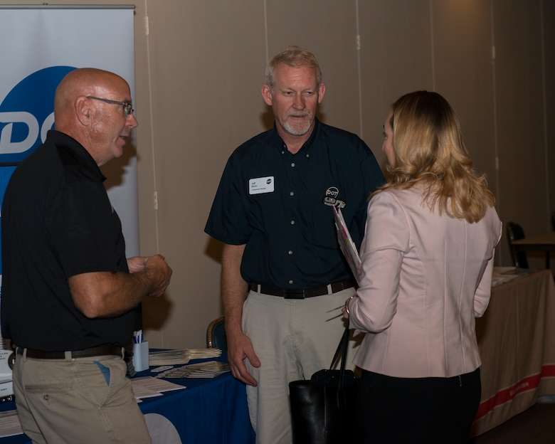 Attendees talk with employers participating in the Airmen and Family Readiness Center spouses job fair, September 25, 2018, at Mountain Home Air Force Base, Idaho. The spouses job fair featured 23 different employers offering positions to Mountain Home AFB personnel and civilians. (U.S. Air Force Photo by Airman 1st Class JaNae Capuno)