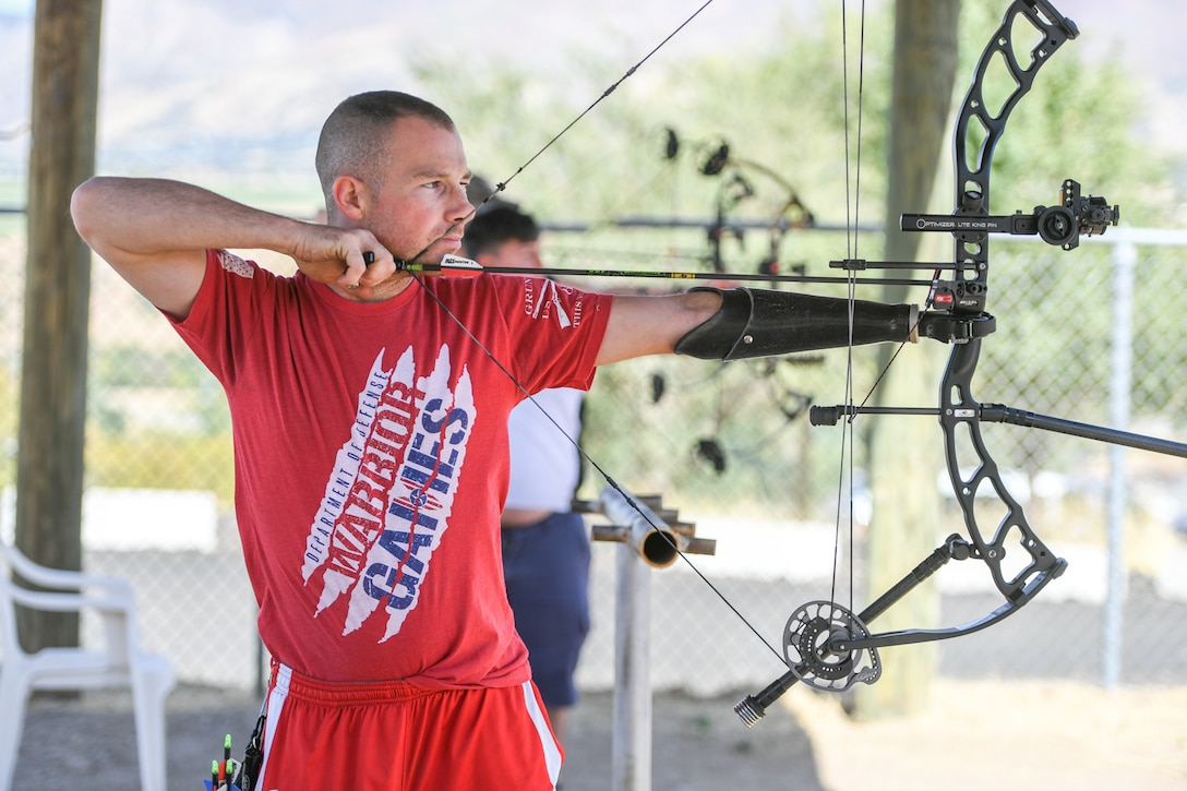 Marine Cpl. T.J. Gilman from Wounded Warrior Batallian West at Camp Pendleton, California, aims his compound bow during a Paralympic Archery Training Camp. Sept. 25, 2018 at Hill Air Force Base. Hill hosted the camp Sept. 24-28 through the Paralympic Military Program, which is run by the United States Olympic Committee in partnership with the U.S. Department of Defense and U.S. Department of Veterans Affairs. (U.S. Air Force photo by Cynthia Griggs)