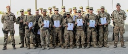 Soldiers of the 101st Resolute Support Sustainment Brigade proudly hold up their certificates of achievement after being recognized in an award ceremony for earning their German proficiency marksmanship badge on Bagram Airfield, Afghanistan, Sept. 14. (U.S. Army photo by: Spc. Alexes Anderson 101st Sustainment Brigade Public Affairs)
