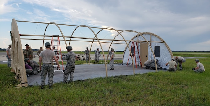 Airmen build a shelter for communications and operations activities 17 September during the Combat Support Wing exercise at Moody AFB, Georgia.