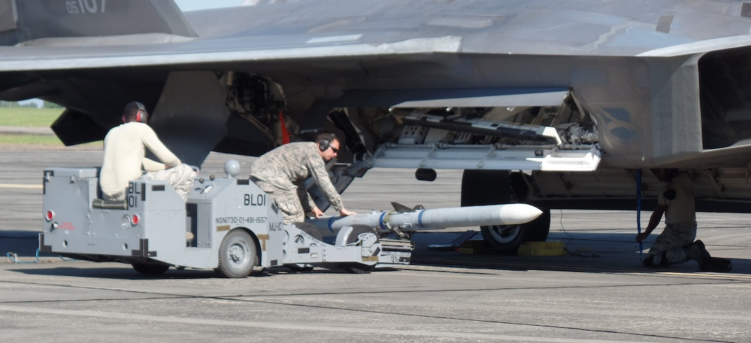 Airmen simulate arming an F-22 Raptor during the Combat Support Wing exercise at Moody AFB, Georgia on 18 September.