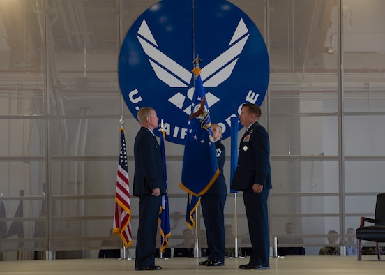 Maj. Gen. Andrew A. Croft, (left) 12th Air Force commander, and Mj. Gen. Patricj Doherty, (right) 19th Air Force commander, roll the Air Combat Command flag on Sept. 28, in hangar 301 on Holloman Air Force Base, N.M. The commanders rolled the ACC flag so the Air Education and Training Command flag could be unfurled. (U.S. Air Force by Airman Autumn Vogt)