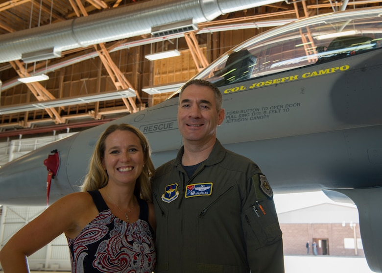 Col. Joseph L. Campo, 49th Wing commander, and his wife Sarah Campo pose in front of the 49th Wing plane. the 49th Wing held a ceremony for its transition to Air Education and Training Command. (U.S. Air Force photo by Airman Autumn Vogt)