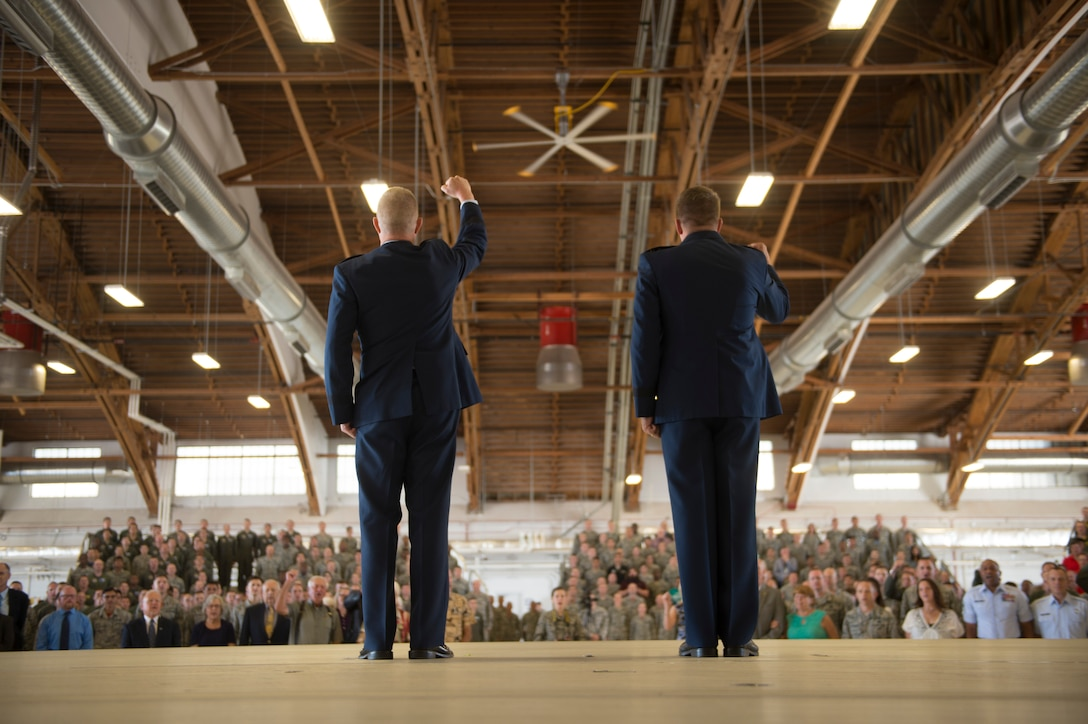 Maj. Gen. Andrew Croft, (left) 12th Air Force commander and Maj. Gen. Patrick Doherty, (right) 19th Air Force commander, sings the Air Force song during the major command reassignment ceremony Sept. 28, on Holloman Air Force Base, N.M. Transitioning to Air Education and Training Command from Air Combat Command will allow the 49th Wing to more effectively execute their mission of training future F-16 Viper and MQ-9 Reaper pilots and sensor operators. (U.S. Air Force photo by Tech. Sgt Amanda N. Junk)