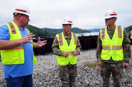 Bill DeBruyn (left) Center Hill Dam Safety Rehabilitation Project resident engineer, briefs Maj. Gen. Mark Toy (center), Great Lakes and Ohio River Division commander, and Lt. Col. Cullen Jones, Nashville District commander, on the progress and construction of the roller compacted concrete berm at the saddle dam in Silver Point, Tenn., Sept. 26, 2018. The saddle dam is nearby Center Hill Dam. (USACE Photo by Mark Rankin)