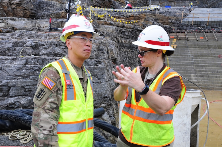 Vanessa Bateman, Nashville District Civil Design Branch chief, updates Maj. Gen. Mark Toy, Great Lakes and Ohio River Division commander, on the roller compacted concrete berm under construction near the saddle dam in Silver Point, Tenn., Sept. 27, 2018.  The saddle dam is nearby Center Hill Dam. (USACE photo by Mark Rankin)