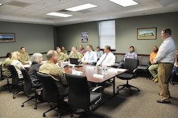 Maj. Gen. Mark Toy, Great Lakes and Ohio River Division commander, receives a briefing during a visit to the Louisville Resident Engineer Office at Fort Campbell, Ky., Sept. 27, 2018. (USACE photo by Mark Rankin)
