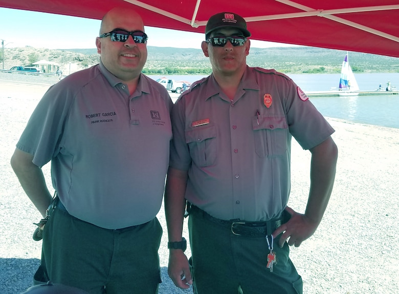 COCHITI LAKE, N.M. -- Park rangers Robert Garcia (left) and Jacob Segura, pause for a photo during the lake's National Public Lands Day event, Sept. 22, 2018
