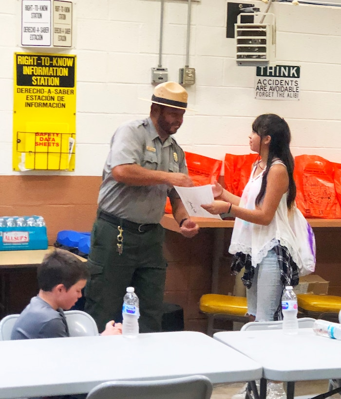 SANTA ROSA LAKE, N.M. – Park Ranger Paul Sanchez presents a certificate of participation to Santa Rosa High School student Anna Lopez, Sept. 22, 2018, for her participation in the National Public Lands Day event at the lake.