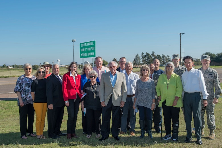 "Distinguished members of the City of Altus and the State of Oklahoma stand in front of a sign dedicating the highway to late U.S. Air Force Col. (Ret.) Aaron ""Burley"" Burleson, former commander of the 97th Air Mobility Wing, during a sign commemoration ceremony, Sept. 28, 2018, at Altus, Okla. To honor Aaron Burleson's achievements to the Altus community and 97th AMW, his family and members of the Oklahoma Congress came to an agreement to name part of State Highway 52 after him. (U.S. Air Force photo by Senior Airman Cody Dowell)"