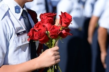 A Junior Reserved Officers' Training Corps student from Rancho High School holds a bouquet of roses at Freedom Field on Nellis Air Force Base, Nev., Sept. 21, 2018. A red rose symbolizes the blood that one comrade has sacrificed and the hope that family and friends have that one day they will return home.  (U.S. Air Force photo by Airman 1st Class Bryan T. Guthrie)