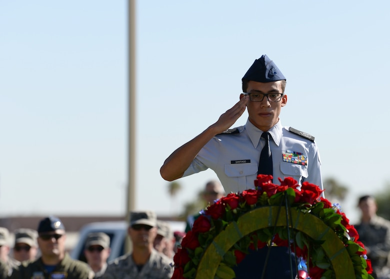 A Reserved Officers' Training Corps student from Rancho High School salutes the wreath of flowers honoring service members at Freedom Park on Nellis Air Force Base, Nev., Sept. 21, 2018. The Prisoners of War/Missing in Action flag were manufactured for distribution in 1972 after Mrs. Michael Hoff contacted Norman Rivkees from Annin and Company to produce a flag to represent service members that were missing. (U.S. Air Force photo by Airman 1st Class Bryan T. Guthrie)