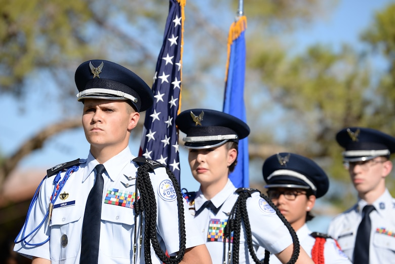 Four Rancho High School Honor Guardsmen stand in preparation for the Prisoner of War/Missing in Action Ceremony at Freedom Park on Nellis Air Force Base Nev., Sept. 21, 2018.  National POW/MIA day falls on every third Friday of September to commemorate service members who have and haven't made it back. (U.S. Air Force photo by Airman 1st Class Bryan T. Guthrie)