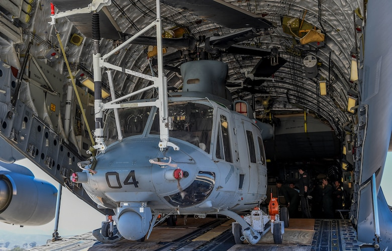 A U.S. Marine Corps UH-1Y Venom sits inside a U.S. Air Force C-17 Globemaster III at Camp Pendleton, Calif., Sept 8, 2018. Airmen from the 4th Airlift Squadron transported the helicopter to the Czech Republic so both aircraft could participate in the NATO Days Air Show held there. (U.S. Air Force photo by Senior Airman Tryphena Mayhugh)