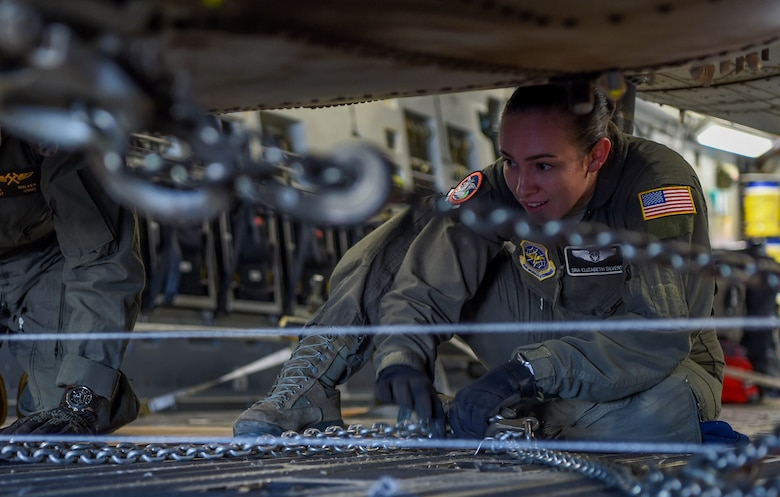 U.S. Air Force Senior Airman Elizabeth Silvers, 4th Airlift Squadron loadmaster, chains a U.S. Marine Corps UH-1Y Venom to a C-17 Globemaster III at Václav Havel Airport Prague, Czech Republic, Sept. 10, 2018. The helicopter had to be held down with safety chains in case it slipped during the offload. (U.S. Air Force photo by Senior Airman Tryphena Mayhugh)