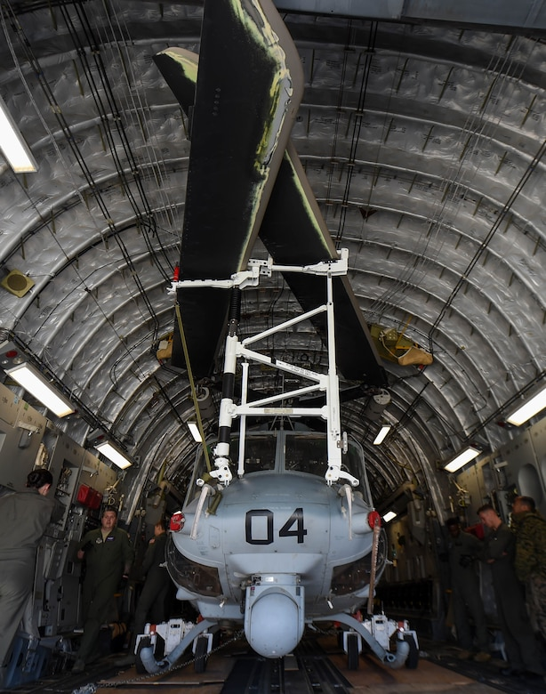 A U.S. Marine Corps UH-1Y Venom sits inside a U.S. Air Force C-17 Globemaster III at Václav Havel Airport Prague, Czech Republic, Sept. 10, 2018. Airmen from the 4th Airlift Squadron transported the helicopter to the Czech Republic so both aircraft could participate in the NATO Days Air Show held there. (U.S. Air Force photo by Senior Airman Tryphena Mayhugh)