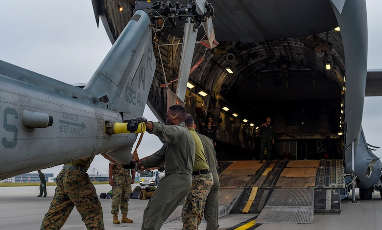U.S. Marine Corps Marines load a UH-1Y Venom onto a U.S. Air Force C-17 Globemaster III at Václav Havel Airport Prague, Czech Republic, Sept. 14, 2018. Nelson and other 4th AS Airmen transported the helicopter and ten Marines to the Czech Republic to participate in the NATO Days Air Show. (U.S. Air Force photo by Senior Airman Tryphena Mayhugh)