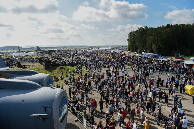 Patrons of the NATO Days Air Show view NATO allies' and partner nation's military ground and aviation equipment on display during the air show in Ostrava, Czech Republic, Sept. 15, 2018. Airmen from the 4th Airlift Squadron, alongside 18 NATO allies and partner nations, provided military ground and aviation equipment for the air show. (U.S. Air Force photo by Senior Airman Tryphena Mayhugh)
