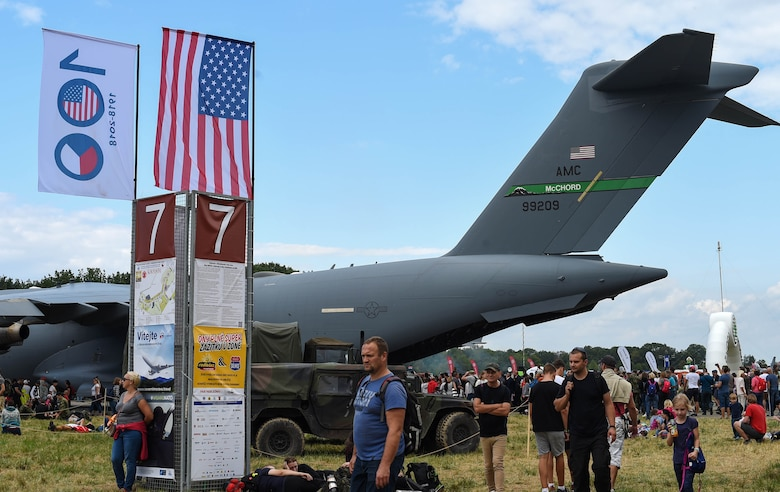 Patrons of the NATO Days Air Show look at U.S. military ground and aviation equipment on display during the air show in Ostrava, Czech Republic, Sept. 15, 2018. McChord Field, Wash., provided a C-17 Globemaster III to be displayed during the air show. (U.S. Air Force photo by Senior Airman Tryphena Mayhugh)
