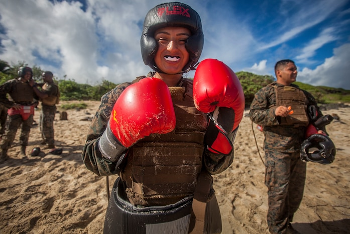 U.S. Marine Corps Cpl. Diana Crawford, a postal clerk with Headquarters Battalion, Marine Corps Base Hawaii (MCBH), poses for a photo during the Marine Corps Martial Arts Instructors Course's (MAIC) culmination, MCBH, Sept. 27, 2018. MAIC is a knowledge driven course that educates students on proper techniques and to properly instruct other Marines to advance their belt level. (U.S. Marine Corps photo by Lance Cpl. Matthew Kirk)