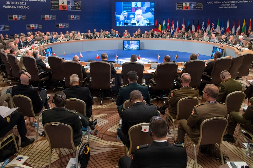 NATO chiefs of defense meet around a large, round table.
