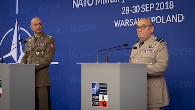 Two NATO officers conduct a news conference.
