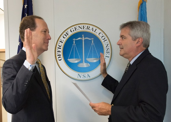 NSA General Counsel Glenn Gerstell receives the oath from Glenn Leuschner Associate Director for Corporate Leadership (l. to r.).