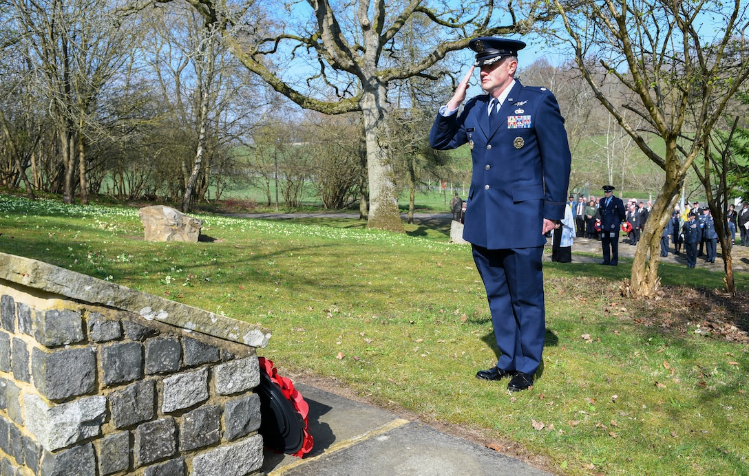 U.S. Air Force Lt. Col. James Roche, 422nd Air Base Group deputy commander, salutes a display at RAF Welford, United Kingdom, March 30, 2019. Annually on the anniversary of the Nuremberg Raid a joint U.S. and U.K. wreath laying ceremony takes place to remember the multinational 101st Squadron crew. (U.S. Air Force photo by Senior Airman Chase Sousa)