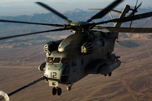 A U.S. Marine Corps CH-53E Super Stallion aircraft assigned to Marine Aviation Weapons and Tactics Squadron One performs a high altitude aerial refuel in support of Weapons and Tactics Instructor course 2-19 in Yuma, Arizona, March 27, 2019. WTI is a seven-week training event hosted by MAWTS-1, which emphasizes operational integration of the six functions of Marine Corps aviation in support of a Marine Air Ground Task Force. WTI also provides standardized advanced tactical training and certification of unit instructor qualifications to support Marine aviation training readiness and assists in developing and employing aviation weapons and tactics.