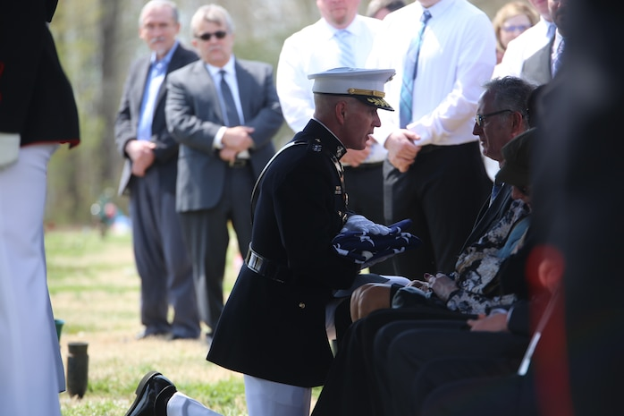 Lieutenant Gen. Mark A. Brilakis, commanding general, U.S. Marine Corps Forces Command, consoles a family member during a full honors funeral for retired Marine Lt. Col. Howard V. Lee, Medal of Honor recipient, at Colonial Grove Memorial Park, Virginia Beach, Virginia, March 30, 2019.