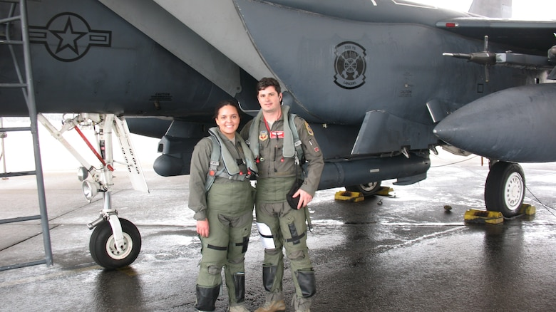 Senior Airman McKayla Dejohnette, 26th Operational Weather Squadron (OWS) weather forecaster, and Capt. Jon Koritz, a 333rd Fighter Squadron F-15E pilot, stand in front of an F-15E Strike Eagle aircraft at Seymour Johnson Air Force Base, North Carolina, Feb. 21, 2019. Dejohnette was one of two 26th OWS Airmen to receive a familiarization flight aboard two F-15E Strike Eagles to see firsthand how their weather products affect the fighters' mission. (Courtesy photo)